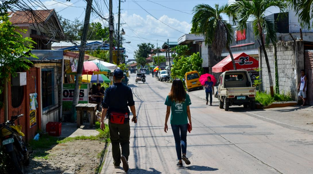A volunteer takes a break during her English language course in the Philippines and goes for a walk through the streets.